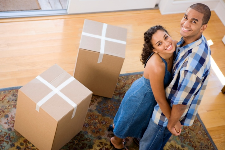 happy-couple-moving-into-a-new-home