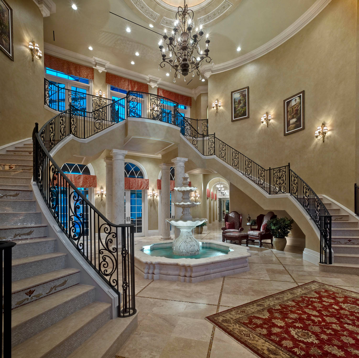 indoor-fountain-marble-grand-staircase-fancy-luxury-home