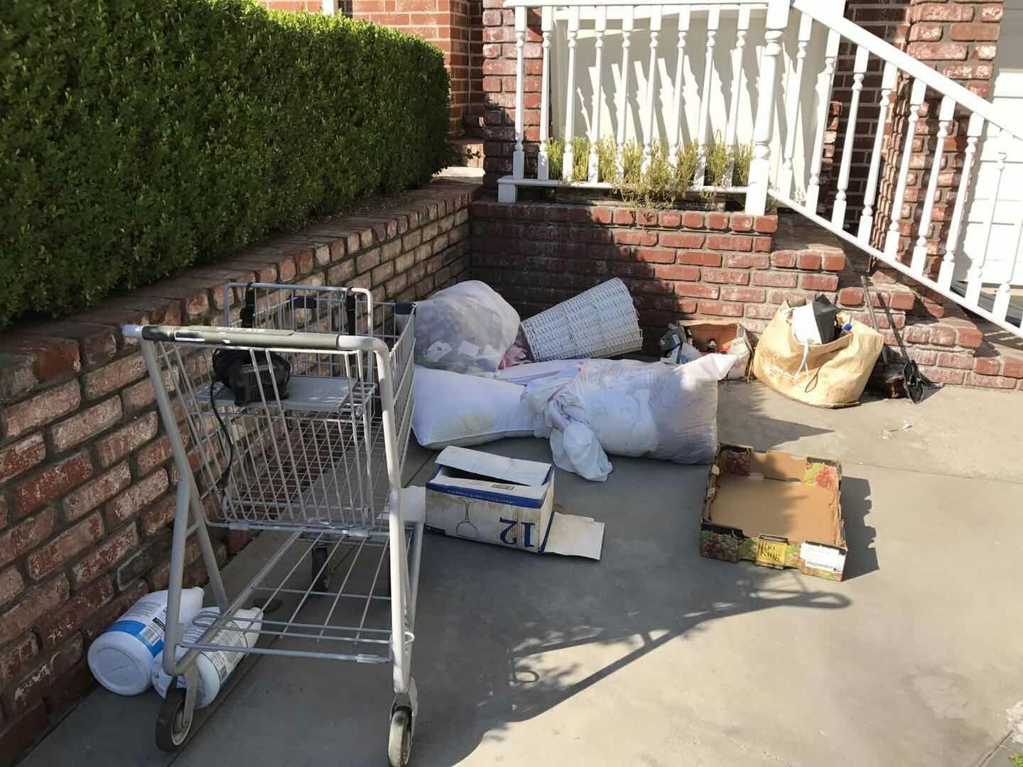 driveway-mess-from-bad-tenant-stolen-shopping-cart